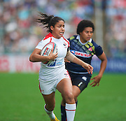 Woman player of the year Magali Harvey on her way to scoring during the Hong Kong Sevens 2015 match between .Canada and Japan at Hong Kong Stadium, Hong Kong on 27 March 2015. Photo by Ian Muir....during the Hong Kong Sevens 2015 match between ........... at Hong Kong Stadium, Hong Kong on 27 March 2015. Photo by Ian Muir.