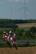 South African Calvin Vlaanderen (10) and Spanish rider Jorge Prado (61) on track.