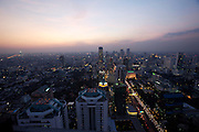 Downtown Bangkok and Sathorn Road at dusk seen from Banyan Tree Hotel's Vertigo Grill & Moon Bar on the 61st floor.