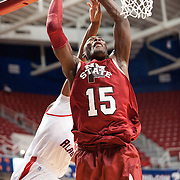 MOBILE, AL - DECEMBER 4:  Tshilidzi Nephawe #15 of the New Mexico State Aggies attempts to dunk the ball over Javier Carter #32 of the South Alabama Jaguars at USA Mitchell Center on December 4, 2012 in Mobile, Alabama. At halftime New Mexico State leads South Alabama 31-25. (Photo by Michael Chang/Getty Images) *** Local Caption *** Tshilidzi Nephawe;Javier Cater