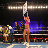"A Capristan Allstar Boxing ring girl walks during the Jonathan ""Bomba"" Gonzalez fights Julian ""El Nino Artillero"" Yedras during a Telemundo boxing match for the WBO Latino Flyweight Title at Osceola Heritage Park on Friday, July 20, 2018 in Kissimmee, Florida.  (Alex Menendez via AP)"