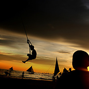 A beach scene at sunset as youngsters play on a rope hanging from a tree at White Beach on October 3, 2008 in Boracay Island, the Philippines. Photo Tim Clayton..Asian tourists at White Beach, Boracay Island, the Philippines...The 4 km stretch of White beach on Boracay Island, the Philippines has been honoured as the best leisure destination in Asia beating popular destinations such as Bali in Indonesia and Sanya in China in a recent survey conducted by an International Travel Magazine with 2.2 million viewers taking part in the online poll...Last year, close to 600,000 visitors visited Boracay with South Korea providing 128,909 visitors followed by Japan, 35,294, USA, 13,362 and China 12,720...A popular destination for South Korean divers and honeymooners, Boracay is now attracting crowds of tourists from mainland China who are arriving in ever increasing numbers. In Asia, China has already overtaken Japan to become the largest source of outland travelers...Boracay's main attraction is 4 km of pristine powder fine white sand and the crystal clear azure water making it a popular destination for Scuba diving with nearly 20 dive centers along White beach. The stretch of shady palm trees separate the beach from the line of hotels, restaurants, bars and cafes. It's pulsating nightlife with the friendly locals make it increasingly popular with the asian tourists...The Boracay sailing boats provide endless tourist entertainment, particularly during the amazing sunsets when the silhouetted sails provide picture postcard scenes along the shoreline...Boracay Island is situated an hours flight from Manila and it's close proximity to South Korea, China, Taiwan and Japan means it is a growing destination for Asian tourists... By 2010, the island of Boracay expects to have 1,000,000 visitors.