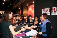 Roma  1 Maggio 2011.Damose da fa'. Semo precari.Manifestazione  di studenti, lavoratori e immigrati che hanno manifestatoo in via del Corso contro i negozi aperti nel giorno della festa dei lavoratori.I manifestanti offrono il caffe' alle commesse nel negozio Tezenis