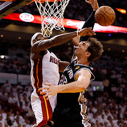 Jun 9, 2013; Miami, FL, USA;  Miami Heat small forward LeBron James (6) blocks the shot of San Antonio Spurs center Tiago Splitter (22) during the fourth quarter of game two of the 2013 NBA Finals at the American Airlines Arena. Mandatory Credit: Derick E. Hingle-USA TODAY Sports