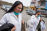 Apr. 27, 2009 -- NOGALES, SONORA, MEXICO: Workers on their lunch break walk through Nogales, Sonora, Mexico Monday with surgical masks to protect themselves from the swine flu. The Mexican government broadened its efforts to control the outbreak of swine flu Monday closing schools throughout the country. In Nogales, on Mexico's northern border with the US, people started wearing masks as news of the outbreak spread.  Photo by Jack Kurtz