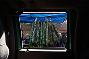 Camouflaged hoodies commonly used by migrants crossing into the United States are seen for sale outside a store in the border town of Sonoyta, Sonora, Mexico.