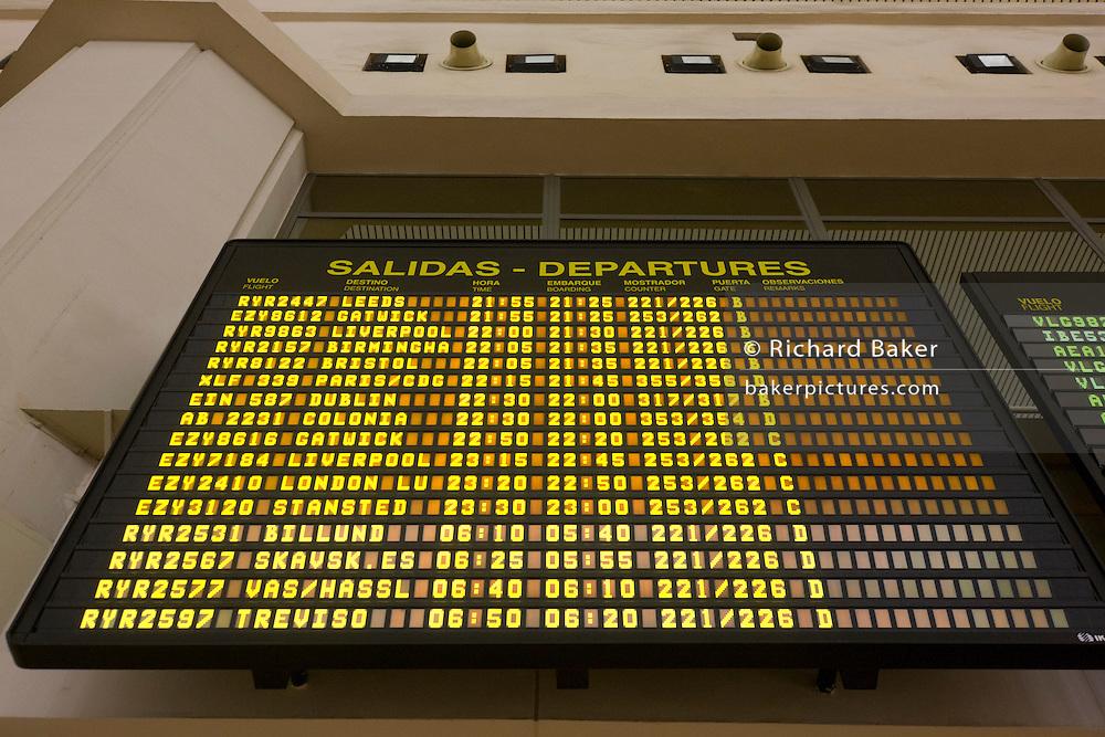 Departures board at Aeropuerto de Malaga, Andalucia.