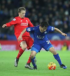 Lucas Leiva of Liverpool (L) and Shinji Okazaki of Leicester City in action - Mandatory byline: Jack Phillips/JMP - 02/02/2016 - FOOTBALL - King Power Stadium - Leicester, England - Leicester City v Liverpool - Barclays Premier League