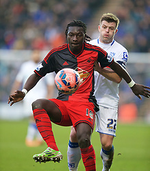 BIRKENHEAD, ENGLAND - Saturday, January 3, 2015: Swansea City's Bafetimbi Gomis and Tranmere Rovers' captain Steve Jennings during the FA Cup 3rd Round match at Prenton Park. (Pic by David Rawcliffe/Propaganda)