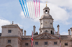 © Licensed to London News Pictures. 10/05/2015. London, UK. A fly-by by the Red Arrows over Horse Guards Parade after war veterans and servicemen parade through Whitehall as part of the VE Day, 70th anniversary celebrations. Photo credit : Stephen Chung/LNP