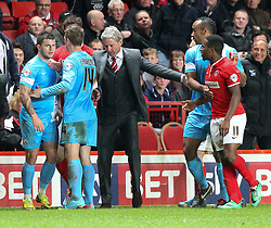 Charlton Athletic Head Coach, Jose Riga keeps Barnsley's Dale Jennings and Charlton Athletic's Chris Solly apart - Photo mandatory by-line: Robin White/JMP - Tel: Mobile: 07966 386802 15/04/2014 - SPORT - FOOTBALL - The Valley - Charlton - Charlton Athletic v Barnsley - Sky Bet Championship