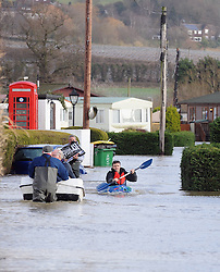 © Licensed to London News Pictures. 03/01/2014<br /> Little Venice residents walking Canoeing or using a boat to get in and out of the country park site.<br /> The Medway River in Yalding has burst its banks again flooding Large parts of Yalding including Little Venice Country Park and The Lees.<br /> Flood waters are back again in Kent as Gales and heavy rain hit the UK over night.<br /> Photo credit :Grant Falvey/LNP