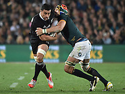 JOHANNESBURG, South Africa, 04 October 2014 : Liam Messam of the All Blacks is tackled by Victor Matfield of the Springboks during the Castle Lager Rugby Championship test match between SOUTH AFRICA and NEW ZEALAND at ELLIS PARK in Johannesburg, South Africa on 04 October 2014. <br /> The Springboks won 27-25 but the All Blacks successfully defended the 2014 Championship trophy.<br /> <br /> © Anton de Villiers / SASPA