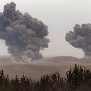 Bombs from a U.S. B-52 kick off an assault against the Taliban in northern Afghanistan, hitting Taliban tank positions in this October 2001 photo.
