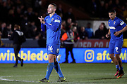 AFC Wimbledon defender Rod McDonald (26) clapping during the The FA Cup match between AFC Wimbledon and West Ham United at the Cherry Red Records Stadium, Kingston, England on 26 January 2019.