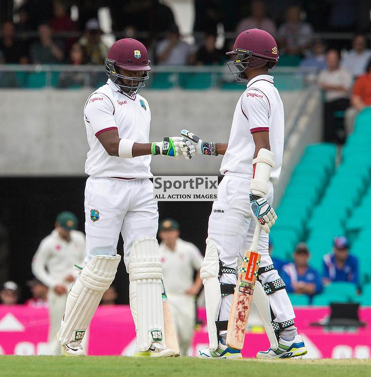 3rd Test Match 2015-16 Day 1, Australia v West Indies, Sydney Cricket Ground; 3 January 2016<br /> West Indian Kraigg Brathwaite and West Indian Darren Bravo celebrate a boundary