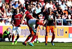 Lewin Nyatanga of Northampton Town is tackled by Leon Clarke of Sheffield United - Mandatory by-line: Robbie Stephenson/JMP - 08/04/2017 - FOOTBALL - Sixfields Stadium - Northampton, England - Northampton Town v Sheffield United - Sky Bet League One