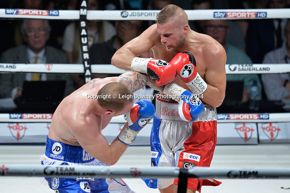 George Groves defeats Christopher Rebrasse (right) for the EBU (European) Super Middleweight Title & Vacant WBC Super Middleweight Title at the SSE Wembley Arena, London on the 20th September 2014. Sauerland Promotions. Credit: Leigh Dawney Photography.