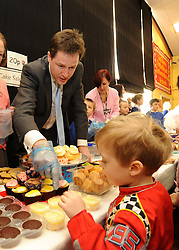 © Licensed to London News Pictures. 27/01/2012, Solihull, UK. NICK CLEGG helps out selling cakes for the schools cake sale during non uniform day. NICK CLEGG  the British Deputy Prime Minister and Liberal Democrat leader is joined by Member of Parliament for Solihull LORLEY BURTat Peterbrook Primary School, Solihull, to see how the local primary school is using its Pupil Premium money. 27th January 2012.   Photo credit : Stephen Simpson/LNP