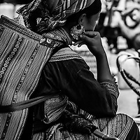 A local tribal lady in her ethnic clothes takes a rest at Sapa market, Vietnam