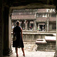 Tourist standing at one of Angkor Wat's temples