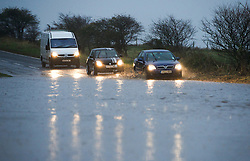 © Licensed to London News Pictures. 26/11/2012..North Yorkshire, England..Commuters driving to work had to negotiate deep puddles following another night of heavy rain that disruption in parts of East Cleveland and North Yorkshire. ..Photo credit : Ian Forsyth/LNP