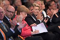 29 JUN 2015, BERLIN/GERMANY:<br /> Angela Merkel (MItte L), CDU Bundesvorsitzende  Bundeskanzlerin, und Sigmnar Gabriel (MItte), SPD Parteivorsitzender und Bundeswirtschaftsminister, und Ursula von der Leyen (MItte R), CDU, Bundesverteidigungsministerin, Festakt anl. des 70. Jubilaeums der Gruendung der CDU, E-Werk<br /> IMAGE: 20150629-01-028<br /> KEYWORDS: Geburtstag, Gründung, Jubiläum, Gespräch, Applaus, applaudieren, klatschen, schreibt, schreiben