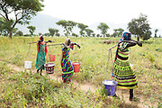Girls carry buckets of water they just filled froma UNICEF-sponsored, pedal-activated pump in the village of Game, Guera province, Chad on Tuesday October 16, 2012.