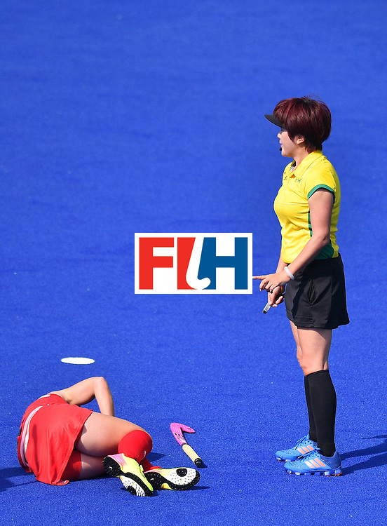 The USA's Katie Bam (L) lies in front of the referee during the women's quarterfinal field hockey USA vs Germany match of the Rio 2016 Olympics Games at the Olympic Hockey Centre in Rio de Janeiro on August 15, 2016. / AFP / Carl DE SOUZA        (Photo credit should read CARL DE SOUZA/AFP/Getty Images)