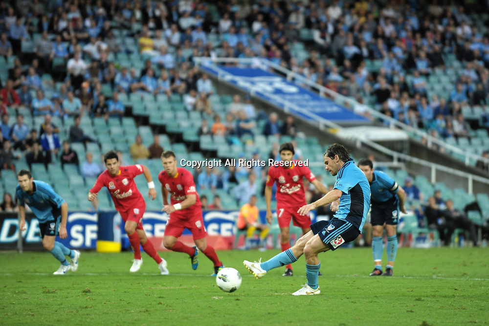 22.12.2011 Sydney, Australia.Sydney midfielder Karol Kisel scores from the penalty spot to level the scores at 1-1 during the A-League game between Sydney FC and Adelaide United played at the Sydney Football Stadium.