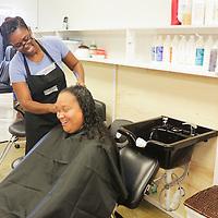 Michelle Munn styles the hair of Lenore Slade at Munn's B Shoppe in Leland, N.C.