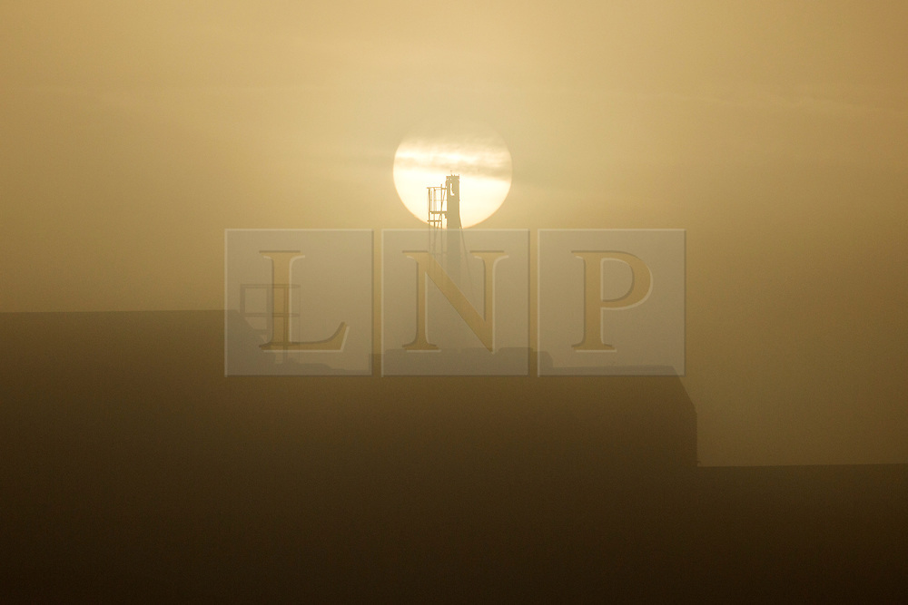 © Licensed to London News Pictures. 20/09/2015. Leeds, UK. Picture shows apartment blocks covered in fog this morning. The city of Leeds woke this morning to a thick blanket of fog which is expected to clear to a mostly dry clear day..Photo credit: Andrew McCaren/LNP