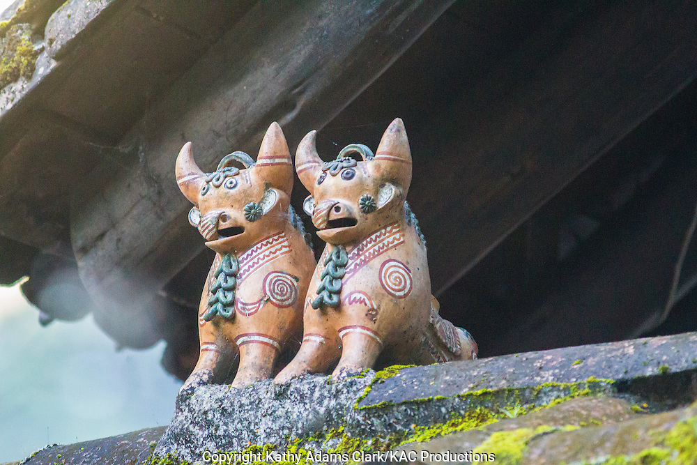 Ornamental bulls put on the top of a house in Peru for good luck, earthenware toritos, little bulls.