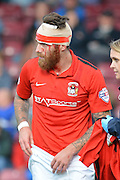 Romain Vincelot with head injury during the Sky Bet League 1 match between Scunthorpe United and Coventry City at Glanford Park, Scunthorpe, England on 12 September 2015. Photo by Ian Lyall.
