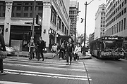 2017 MARCH 05 - People walk up Pine St at 4th Ave near Emerald City Comicon, downtown, Seattle, WA, USA. By Richard Walker