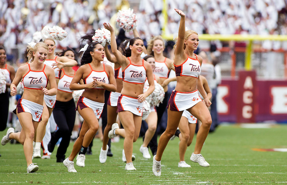 Sept 8, 2012; Blacksburg, VA, USA;  The Virginia Tech Hokies cheerleaders run onto the field before the game against the Austin Peay Governors at Lane Stadium. Mandatory Credit: Peter Casey-USA TODAY Sports