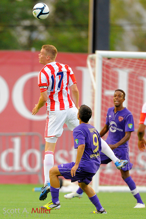 Stoke City Potters defender Ryan Shawcross (17) goes airborne for a ball against the Orlando City Lions at the Florida Citrus Bowl on July 28, 2012 in Orlando, Florida. Stoke won 1-0...© 2012 Scott A. Miller.