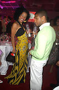 Usher and Sophie Okonedo. Glamour Women Of The Year Awards 2005, Berkeley Square, London.  June 7 2005. ONE TIME USE ONLY - DO NOT ARCHIVE  © Copyright Photograph by Dafydd Jones 66 Stockwell Park Rd. London SW9 0DA Tel 020 7733 0108 www.dafjones.com