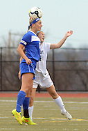 Downingtown West's Melana Paternoster #18 and CB East's #24 head the ball in the first half Saturday November 7, 2015 in Souderton, Pennsylvania.  (Photo by William Thomas Cain)