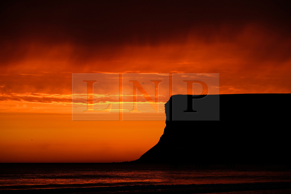 © Licensed to London News Pictures. <br /> 20/09/2017 <br /> Saltburn by the Sea, UK.  <br /> <br /> A brief but dramatic sky is lit up over Huntcliff in Saltburn by the Sea as the sun begins to rise.<br /> <br /> Photo credit: Ian Forsyth/LNP