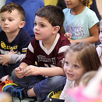 Adam Robison | BUY AT PHOTOS.DJOURNAL.COM<br /> Jake Smith, 4, a student at the Kangaroo's Pouch Day Care Center in Pontotoc, listens with his classmates as his teacher Jeanie Doler reads to them.
