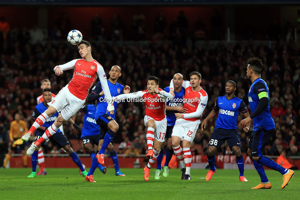 25 February 2015 - UEFA Champions League - Last 16 (1st Leg) - Arsenal v AS Monaco - Laurent Koscielny of Arsenal heads the ball gaolbird in the 1st half - Photo: Marc Atkins / Offside.
