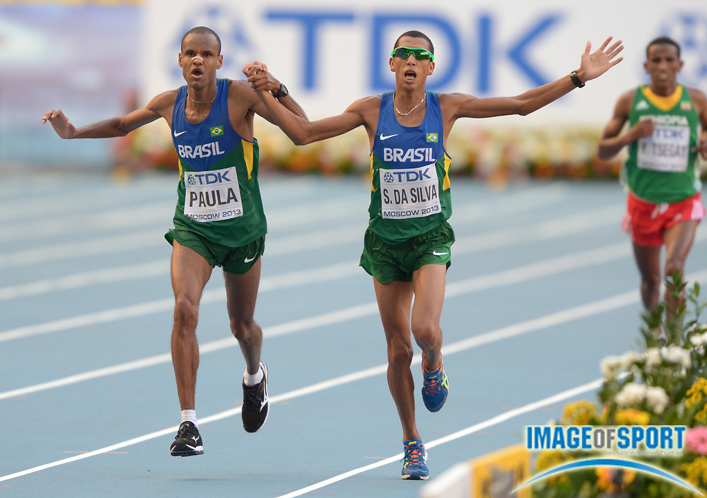 Aug 17, 2013; Moscow, RUSSIA; Paulo Roberto Paula (left) and Solonei Da Silva (BRA) holds hands at the finish of the marathon in the 14th IAAF World Championships in Athletics at Luzhniki Stadium.