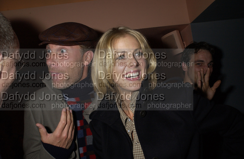 Damian Aspinall and Donna Air. Frost French party. Light Bar. St Martin's Lane hotel. 18 September 2001. © Copyright Photograph by Dafydd Jones 66 Stockwell Park Rd. London SW9 0DA Tel 020 7733 0108 www.dafjones.com