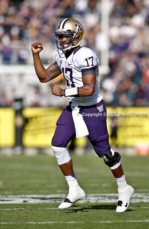 SHOT 11/17/12 1:43:24 PM - Washington's Keith Price #17 celebrates after throwing a touchdown pass against Colorado during their Pac-12 regular season game at Folsom Field in Boulder, Co. Washington won the game 38-3. (Photo by Marc Piscotty / © 2012)