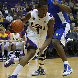 Jan 04, 2010; Baton Rouge, LA, USA;  LSU Tigers forward Tasmin Mitchell (1) drives past McNeese State Cowboys forward Will Morning (1) during the second half at the Pete Maravich Assembly Center. LSU defeated McNeese State 83-60.  Mandatory Credit: Derick E. Hingle-US PRESSWIRE