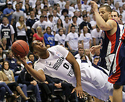BYU forward Brandon Davies (0) attempts to score as he falls as St. Mary's forward Rob Jones, right defends during the first half of an NCAA college basketball game in Provo, Utah, Saturday, Jan. 28, 2012. (AP Photo/Colin E Braley)