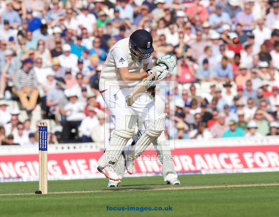 Joe Root of England ducks to avoid the bouncer from Mitchell Johnson of Australia while batting during the 5th Investec Ashes Test Match match at the Kia Oval, London<br /> Picture by Alan Stanford/Focus Images Ltd +44 7915 056117<br /> 21/08/2015