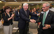 Former Texas governor Mark White, center, acknowledges the crowd after Houston ISD trustees voted to name a new school in his honor during a Board of Education meeting, June 12, 2014.