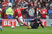 Nottingham Forest midfielder Ben Osborn (11) has an attempt at goal with Reading goalkeeper Ali Al-Habsi (26) closing in during the EFL Sky Bet Championship match between Nottingham Forest and Reading at the City Ground, Nottingham, England on 22 April 2017. Photo by Jon Hobley.